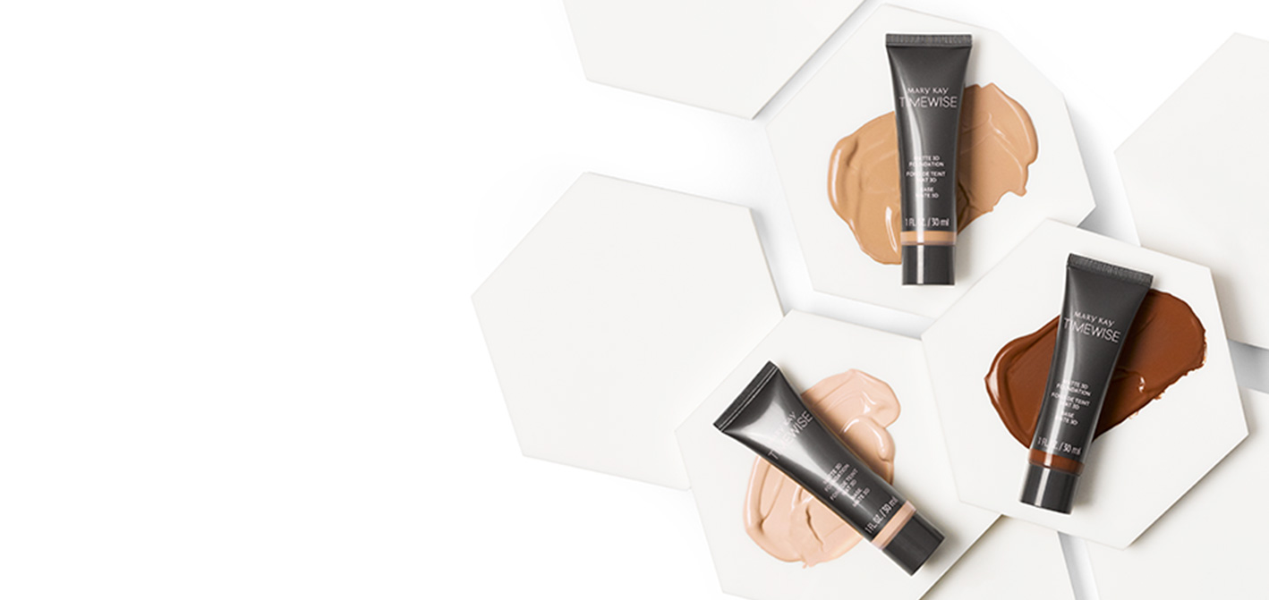 Mary Kay TimeWise 3D Foundation product tubes and swatches on white hexagons