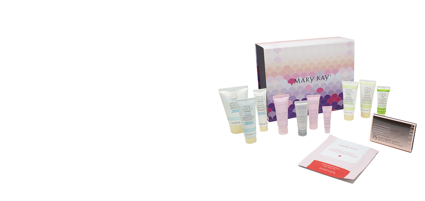 Mary Kay® skin and body care minis in a pink and purple box.