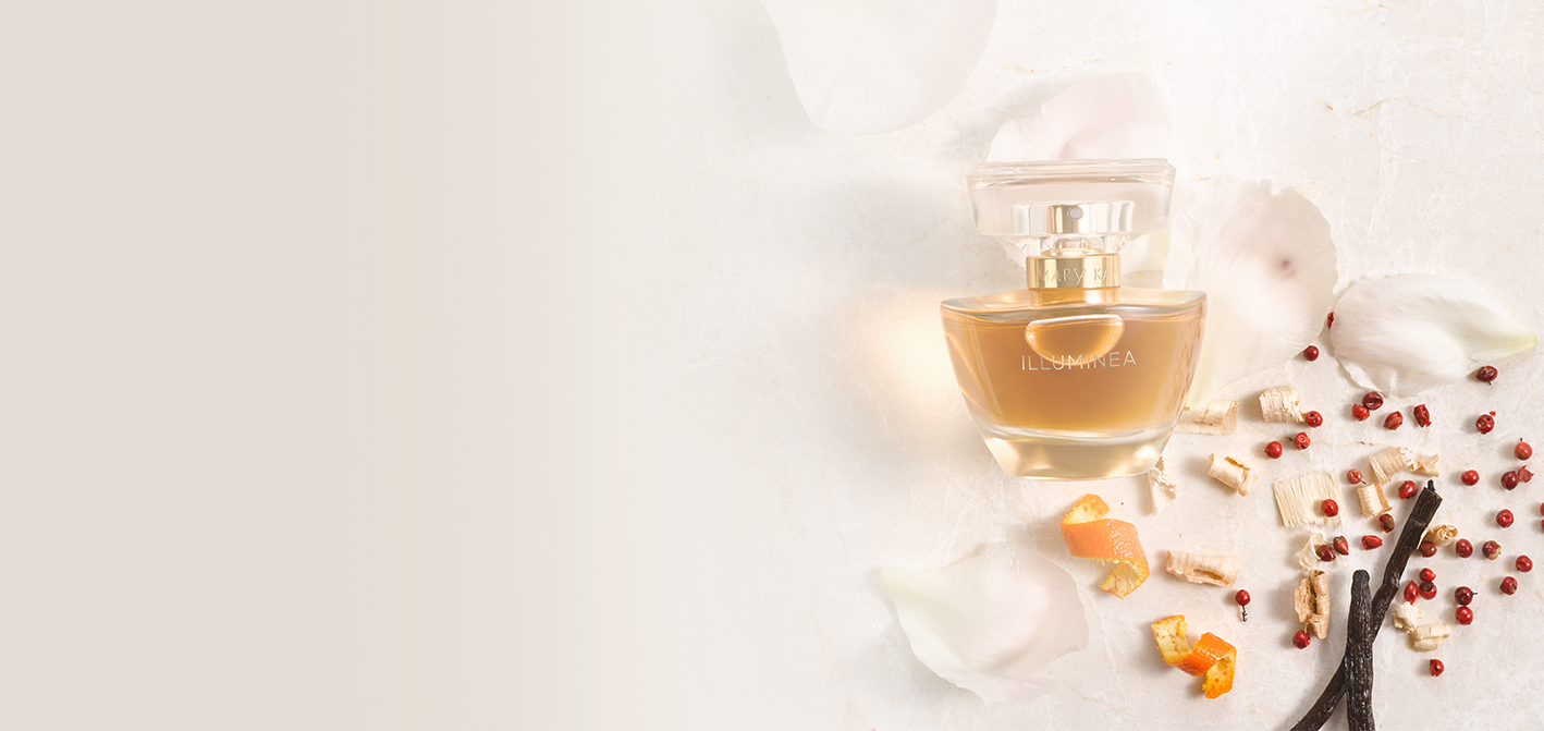 Illuminea Extrait de Parfum with its ingredients on textured fabric.
