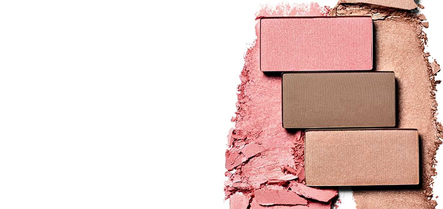 Three pans of new Mary Kay Chromafusion Blush, Highlighter and Contour are shown atop swipes of product.
