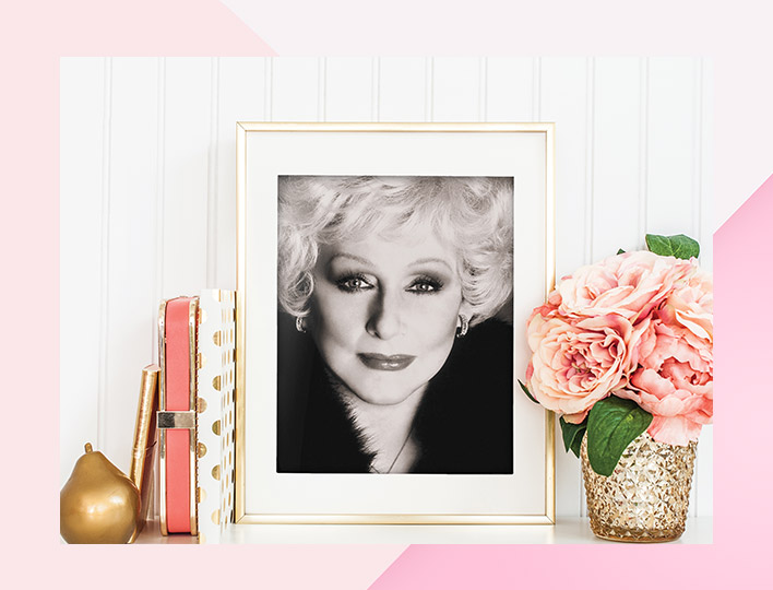 Photo of Mary Kay amongst floral and notebook décor.