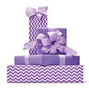 Gifts wrapped in purple and patterned wrapping paper.