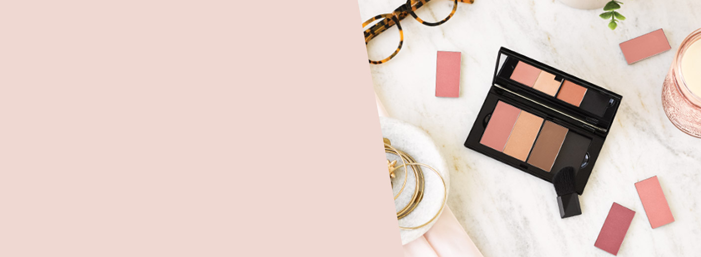 Eyeglasses, accessories and Mary Kay makeup products lie on a marble countertop beside the NEW Mary Kay Perfect Palette.