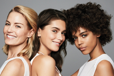 Three female models for skin care.