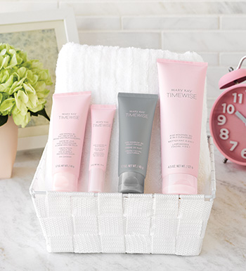 A picture of the TimeWise Miracle Set 3D anti-aging skin care set in pink and gray tubes on a white bathroom counter