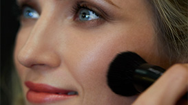 Mary Kay Chromafusion Blush being applied to model's cheek.