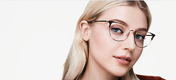 Model wearing glasses representing Mary Kay eye area product testing.