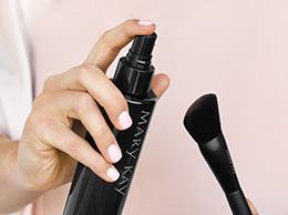 Close-up of Mary Kay Brush Cleaner posed to be sprayed on the Mary Kay Cheek Brush.