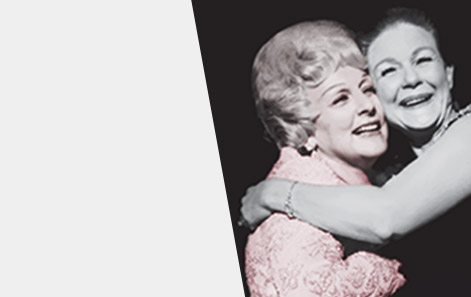 Mary Kay Ash embraces a member of the Mary Kay Independent Sales Force in a warm hug both as women smile.