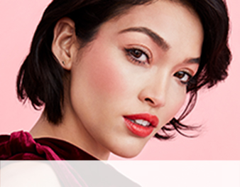 Close up of model wearing Fall Back to Summer look from Mary Kay against pink background