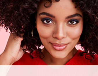 Close up of model wearing Starry Eyes look from Mary Kay against pink background