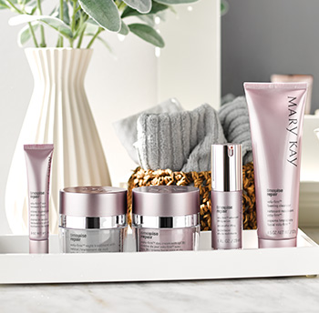 A picture of TimeWise Repair eye cream in a purple tube, night cream in a silver and purple jar, day cream with SPF sunscreen in a purple jar, advanced lifting serum in a purple and silver bottle and foaming cleanser in a purple tube on a counter top