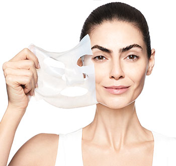 Learn more about the NEW TimeWise Repair Lifting Bio-Cellulose Mask from Mary Kay and how you can see a visible lift in just two weeks.  Image of smiling woman peeling mask from her radiant skin.