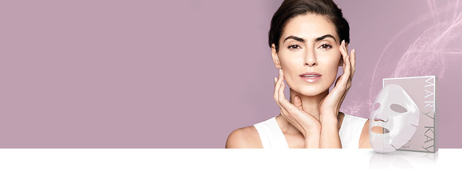 Watch the video and learn how NEW TimeWise Repair Lifting Bio-Cellulose Mask from Mary Kay works. See a visible difference in just two weeks. Image shows white background with square on right side. In square is a woman lightly touching her face with a purple background. A video play button is shown in bottom left corner of square.