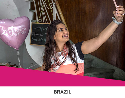 Mary Kay Independent Beauty Consultants giving students makeovers and makeup tutorials during Global Day of Beauty in Brazil.