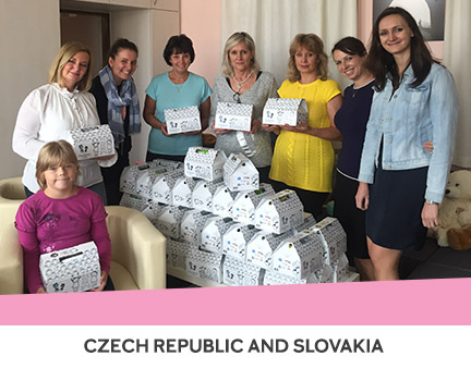 Mary Kay Czech Republic/Slovakia posing with breakfasts served at a temporary children's home.