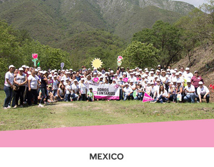 Mary Kay employees and their families planting hundreds of trees in Mexico on Planting Day.