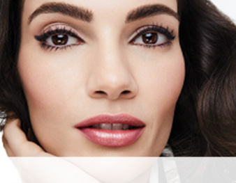 Close-up of model wearing the Day To Night makeup artist look from Mary Kay against a white background.